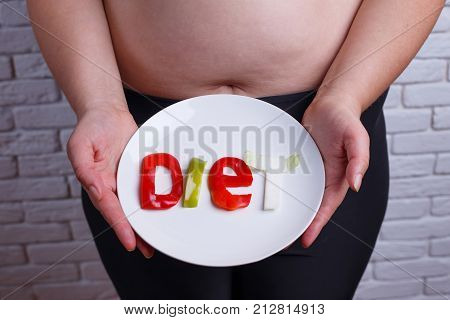 Word Diet Carved Of Vegetables On The Plate In Hands Of Overweight  Unrecognizable Woman. Diet, Nutr