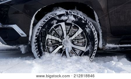 Winter all-terrain tire tread packed with snow stock photo