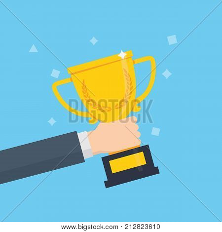Winner trophy award. People holding winner's trophy cup. Male hand holding golden trophy cup