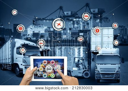 Hand holding tablet is pressing button Logistics connection technology interface global partner connection for logistic import export background for Concept of fast or instant shipping Online goods orders worldwide internet of things