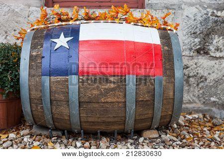 Texas flag painted on wooden barrel / Oak wine barrel with Texas flag painted on used as decoration