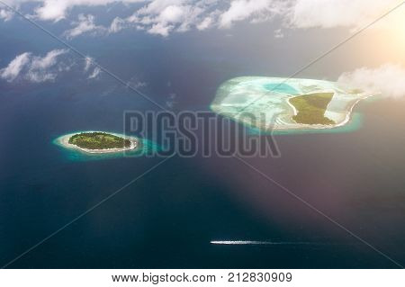 Tropical Islands And Atolls In Maldives In Indian Ocean From Aerial View. Cutting Wave Boat. Piece O