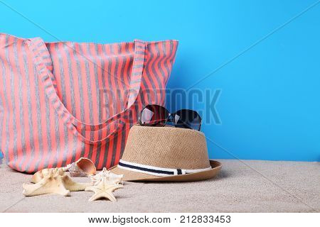 Summer Bag With Hat, Sunglasses And Starfish On Beach Sand