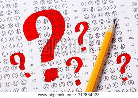 Blank multiple choice answer sheet empty with pencil. How to correctly answer test questions question marks are drawn