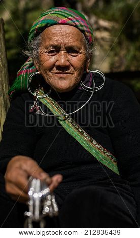 LAO CAI SAPA -VIETNAM - NOV42017 : close up face of unidentified old woman of sapa hill tribe selling woman silver accessories