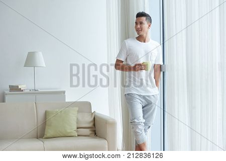 Portrait of smiling Vietnamese man in comfy clothes