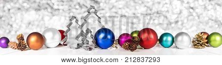 Christmas Balls, Cones And Fir Trees In Front Of White Shiny Background