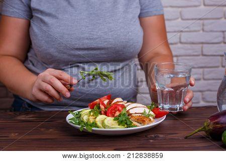 Diet Concept, Healthy Lifestyle, Low Calorie Food. Fat Woman Eat