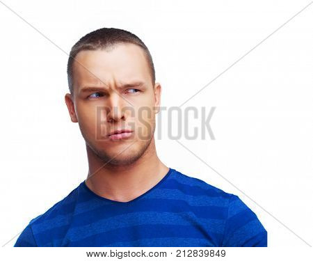 worried suspicious young man isolated against white studio background