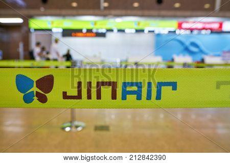 BUSAN, SOUTH KOREA - CIRCA MAY, 2017: close up shot of Jin Air sign at Gimhae International Airport, Domestic Terminal.