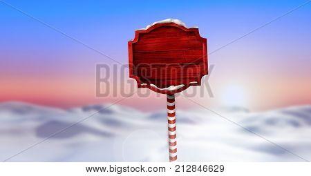 Digital composite of Wooden signpost in Christmas Winter landscape