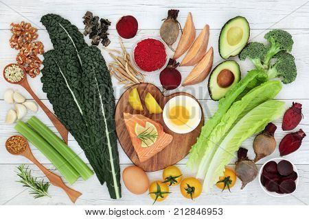 Brain boosting super food with fish, vegetables, seeds, nuts, dairy and herbs. Foods high in omega 3, vitamins, minerals, antioxidants and anthocyanins.