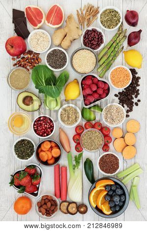 Diet super food  ingredients with herbs used as appetite suppressants, fruit, vegetables, nuts, seeds, grains cereals and legumes. Super foods high in antioxidants, anthocyanins, fiber and vitamins.