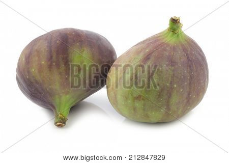 two figs (Ficus carica) on a white background