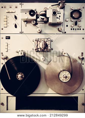 Antique recording machine with film tapes, reels and switches. Vintage movie industry.