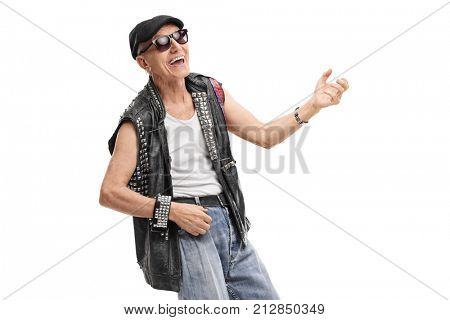 Old punk rocker playing air guitar isolated on white background