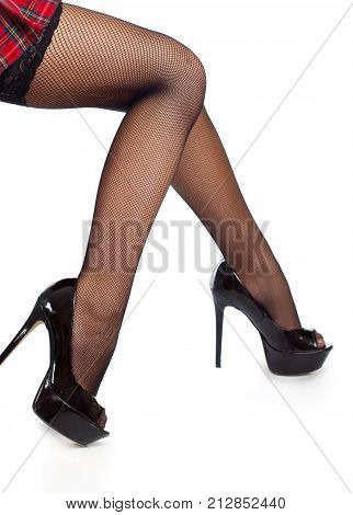 Close-up of beautiful sexy legs in black stockings and red skirt. Isolated on a white background