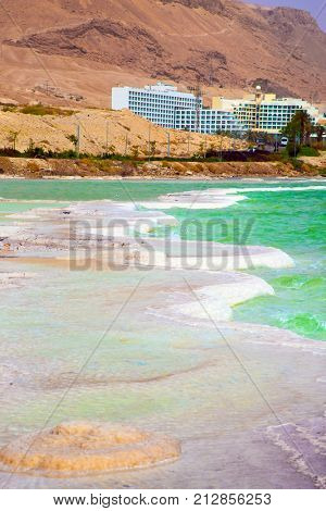 Israel, spring. Forever Living Dead Sea. Picturesque islands of medicinal salt in the lake. The concept of ecological and medical tourism