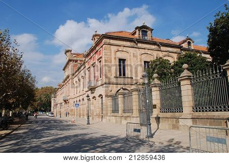 BARCELONA, SPAIN - NOVEMBER 1, 2017: Exterior of the Parliament of Catalonia in Ciutadella park in Barcelona. Originally built as an arsenal, the building dates from 1727.
