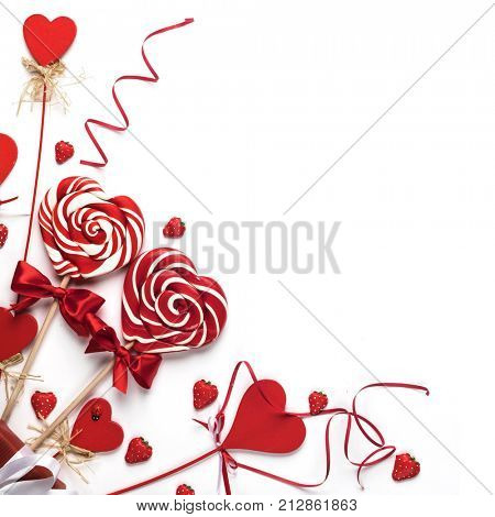 Valentines day decoration and heart shaped lollipops isolated on white background
