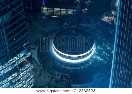 MOSCOW - DEC 15, 2013: Round building in Moscow International Business Center at night. Years of construction of complex - 1995-2018