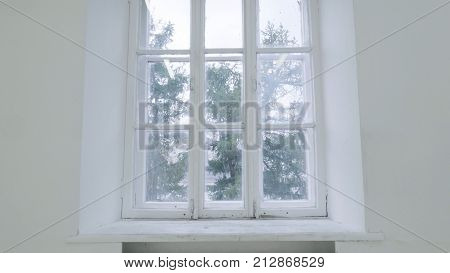 Blank white wall with window. Slide motion of movement or hitting the camera on empty light white room with window. Construction Home Empty room interior window aluminum on wall