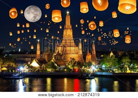 Floating lamp in yee peng festival under loy krathong day at wat arun Full moon at night in bangkok city Thailand
