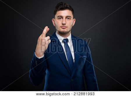 Serious Executive Manager Holding Fingers Crossed