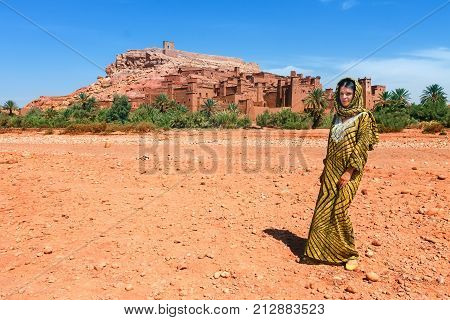 European tourist in picturesque mountain village kasbah Ait Ben Haddou not far from Ouarzazate in Morocco, Africa.