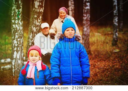 grandparents with kids walk in nature, grandparenting concept