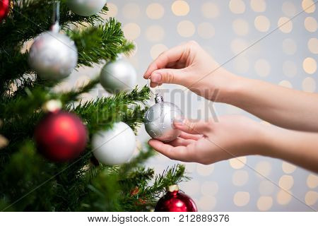 Christmas Background - Woman Decorating Christmas Tree
