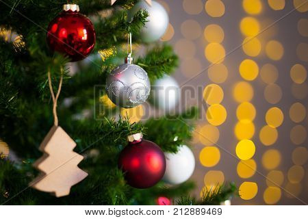 Holiday Background - Close Up Of Decorated Christmas Tree With Golden Lights