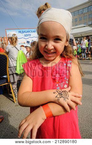 Happy Girl On Open Day Of Sberbank. Tyumen