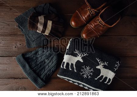 Male Winter Clothing On A Brown Wooden Background.