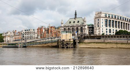 Blackfriars Pier on River Thames, London, England, with architecture on riverbank