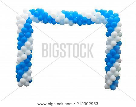 Colorful arch of white and blue balloons isolated over background .