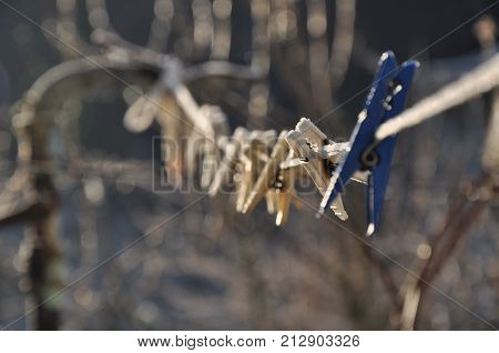 Clothes peg on a frozen winter day