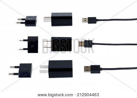 Black battery charger. Mobile phone usb cable port charger isolated on white background. Technology gadget accessory concept.