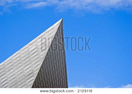an abstract image of a point from a building pointing out into the sky poster