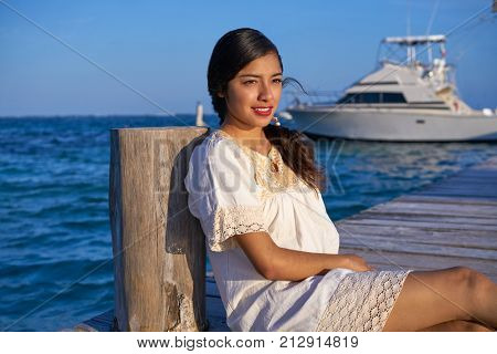 Mexican latin woman with ethnic dress in caribbean sea at Riviera Maya