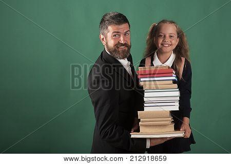 Girl In School Uniform And Bearded Man In Suit