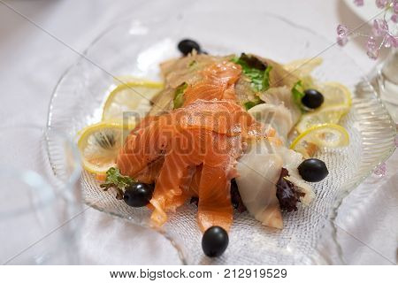 Salad of tuna with chips in a white plate close-up