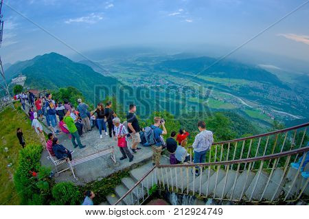 POKHARA, NEPAL, SEPTEMBER 04, 2017: Unidentified tourist walking upstairs at hilltop of the Sarangkot lookout point in the mountain to view Annapurna Range during sunrise at Sarangkot, Nepal, fish eye effect.