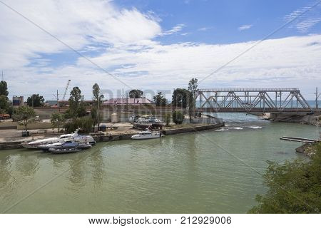 Kudepsta, Hosta District, Krasnodar region, Russia - July 10, 2016: View of the railway bridge over the river Kudepsta and place of the river flows into the Black Sea