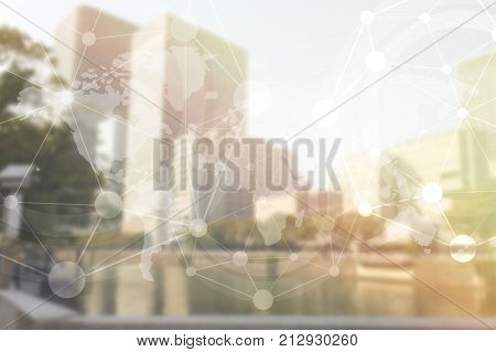 Double exposure of Blurred building and world map for business and financial background product.
