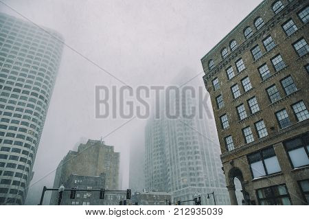 falling snow in downtown Boston. snowstorm among the high-rise buildings