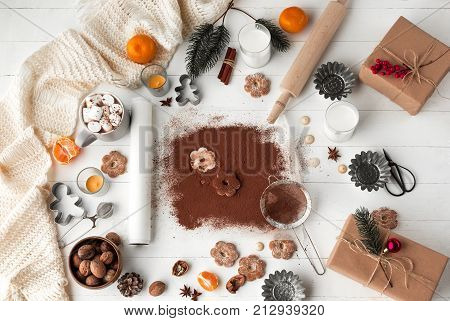 Homemade bakery making, gingerbread cookies in form of Christmas tree close-up. New year treat for Santa Claus cooking. Homemade bakery, xmas sweet, winter holidays concept.