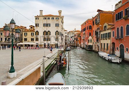 Venice, Italy - April, 2016: Canal in Venice, Italy. Venice cityscape, narrow water canal and traditional buildings. Italy, Europe. Italy beauty, silence on typical canal street in Venice, Venezia.