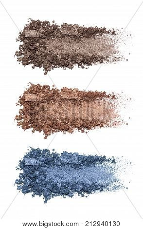 Set of eyeshadow sample isolated on white background. Crushed brown and blue metallic eyeshadow. Closeup of a makeup product.
