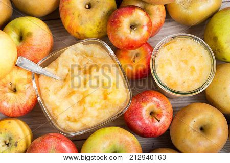 a stewed apples with apples on a wooden table